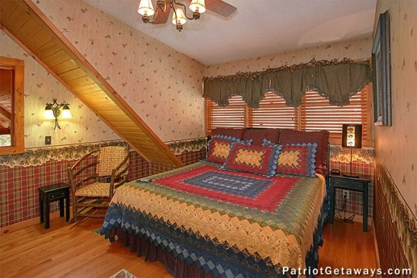 King bed in an upstairs bedroom at Stags Leap, a 2 bedroom cabin rental located in Pigeon Forge
