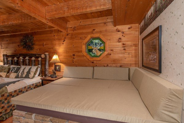 Cozy window seat in the king bedroom at Stags Leap, a 2 bedroom cabin rental located in Pigeon Forge