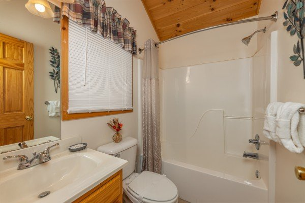 Bathroom with a tub and shower at Honeysuckle Hideaway, a 1 bedroom cabin rental located in Pigeon Forge