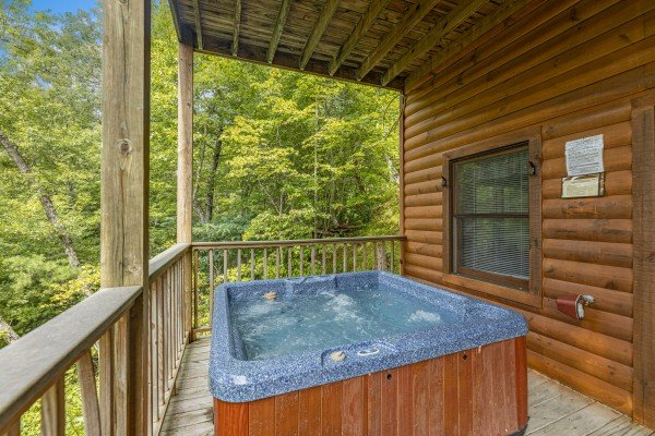 Hot tub at Honeysuckle Hideaway, a 1 bedroom cabin rental located in Pigeon Forge