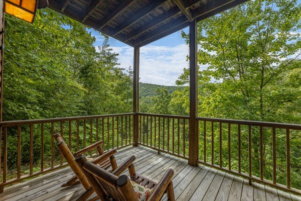 Wooded porch view at Honeysuckle Hideaway, a 1 bedroom cabin rental located in Pigeon Forge