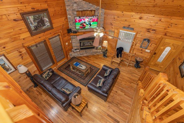 Looking down at the living room at Almost Bearadise, a 4 bedroom cabin rental located in Pigeon Forge