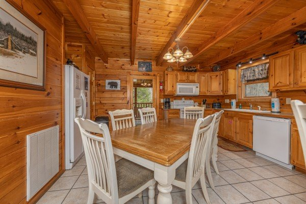 Dining table for six in the kitchen at Almost Bearadise, a 4 bedroom cabin rental located in Pigeon Forge