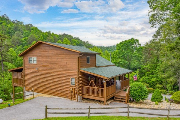 Driveway and fence at Almost Bearadise, a 4 bedroom cabin rental located in Pigeon Forge