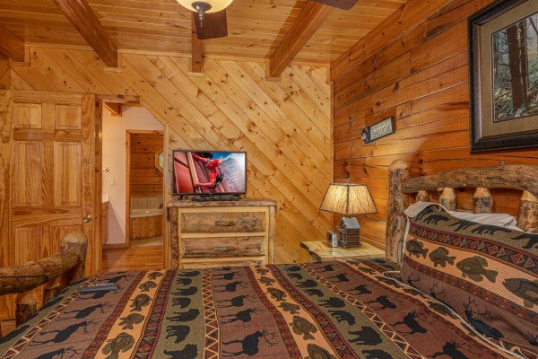 Dresser and TV in a bedroom at Almost Bearadise, a 4 bedroom cabin rental located in Pigeon Forge