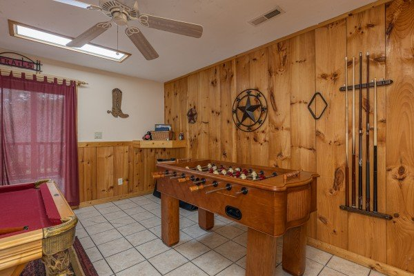 Foosball table in the game room at Almost Bearadise, a 4 bedroom cabin rental located in Pigeon Forge