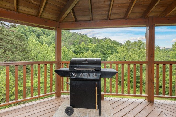 Grill on a covered deck at Almost Bearadise, a 4 bedroom cabin rental located in Pigeon Forge
