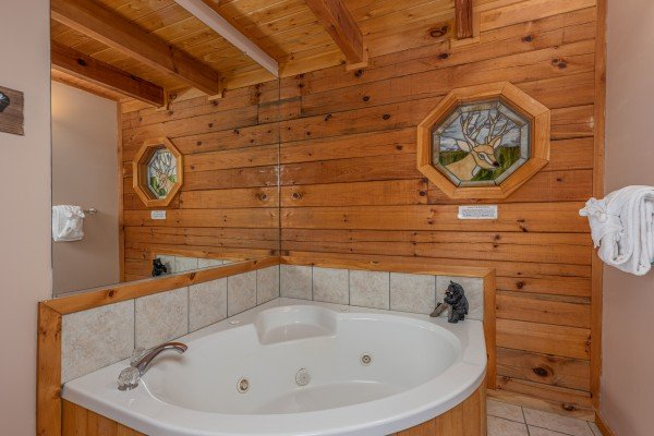 Jacuzzi tub in a bathroom at Almost Bearadise, a 4 bedroom cabin rental located in Pigeon Forge