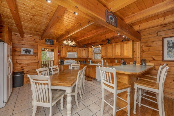 Dining space and kitchen at Almost Bearadise, a 4 bedroom cabin rental located in Pigeon Forge