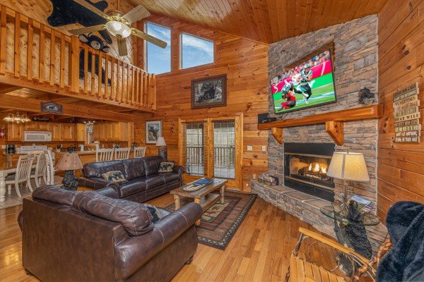 Living room with vaulted ceiling, fireplace, and TV at Almost Bearadise, a 4 bedroom cabin rental located in Pigeon Forge