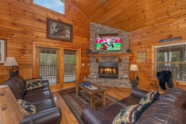 Fireplace and TV in a living room at Almost Bearadise, a 4 bedroom cabin rental located in Pigeon Forge