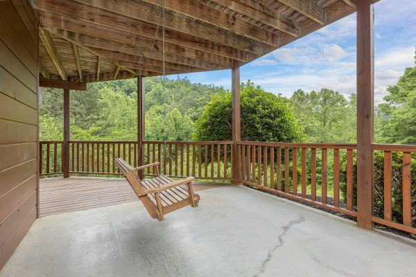 Lower deck porch swing at Almost Bearadise, a 4 bedroom cabin rental located in Pigeon Forge