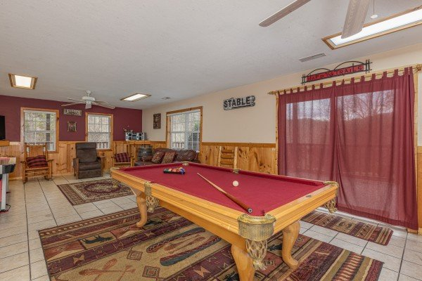Pool table in a game room at Almost Bearadise, a 4 bedroom cabin rental located in Pigeon Forge