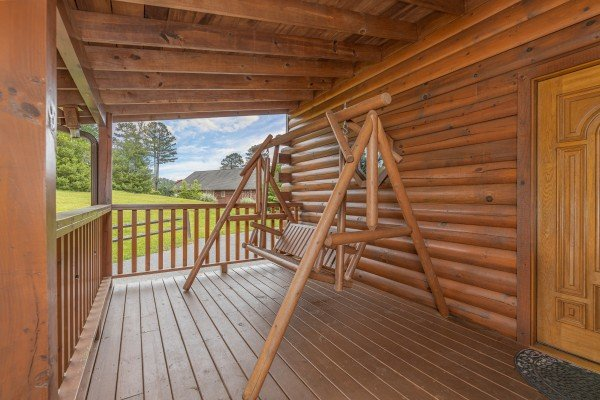 Porch swing at Almost Bearadise, a 4 bedroom cabin rental located in Pigeon Forge