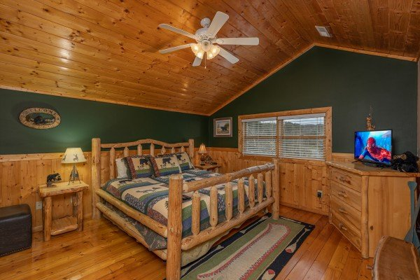 Loft bedroom with TV and dresser at Almost Bearadise, a 4 bedroom cabin rental located in Pigeon Forge