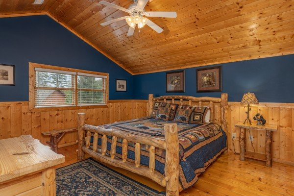 Bed, dresser, and night table at Almost Bearadise, a 4 bedroom cabin rental located in Pigeon Forge