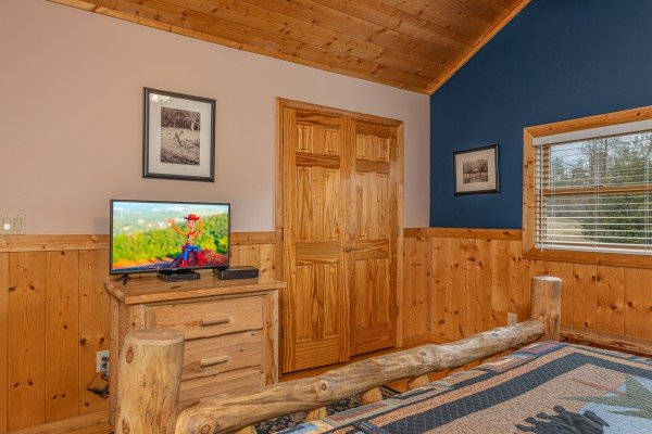 Television in a bedroom at Almost Bearadise, a 4 bedroom cabin rental located in Pigeon Forge