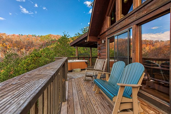 Deck bench and rocking chair at R & R Hideaway, a 1 bedroom cabin rental located in Pigeon Forge