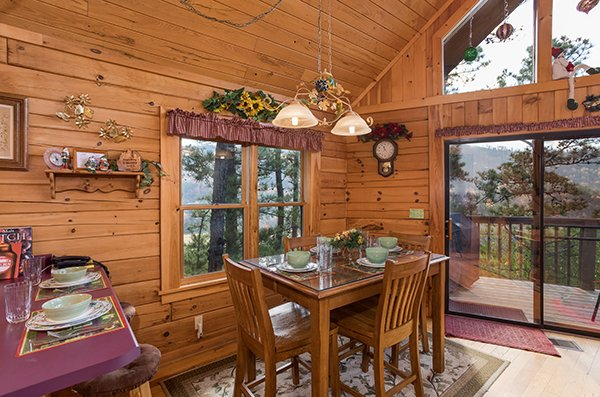 Dining table for four at R & R Hideaway, a 1 bedroom cabin rental located in Pigeon Forge