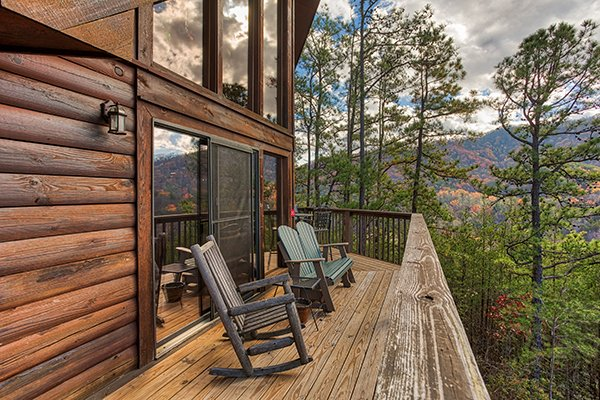 Seating on the deck at dusk at R & R Hideaway, a 1 bedroom cabin rental located in Pigeon Forge