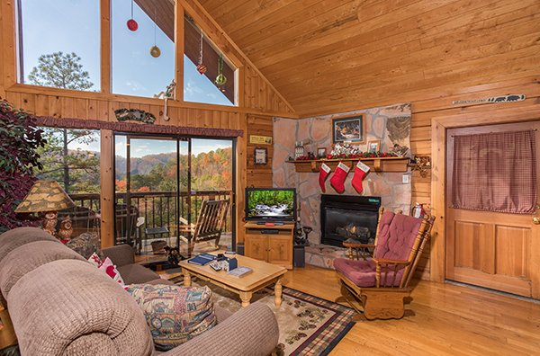 Living room with amazing views, TV, and fireplace at R & R Hideaway, a 1 bedroom cabin rental located in Pigeon Forge