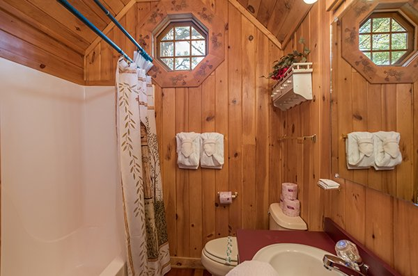 Loft bathroom with tub and shower at R & R Hideaway, a 1 bedroom cabin rental located in Pigeon Forge