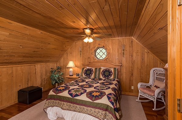 Queen bed in the loft at R & R Hideaway, a 1 bedroom cabin rental located in Pigeon Forge