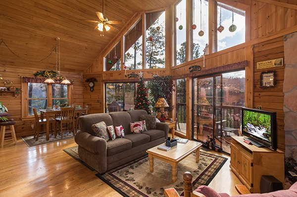 Living room with amazing views and a TV at R & R Hideaway, a 1 bedroom cabin rental located in Pigeon Forge