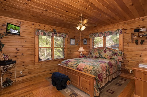 Queen bedroom on the main floor at R & R Hideaway, a 1 bedroom cabin rental located in Pigeon Forge
