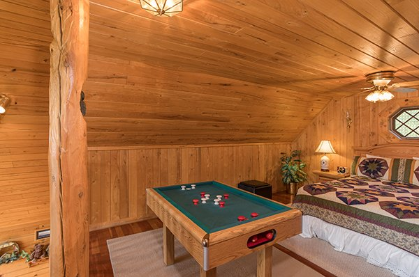 Bumper pool table in the loft bedroom at R & R Hideaway, a 1 bedroom cabin rental located in Pigeon Forge