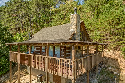 exterior view of the cabin at a postcard view a 1 bedroom cabin rental located in pigeon forge