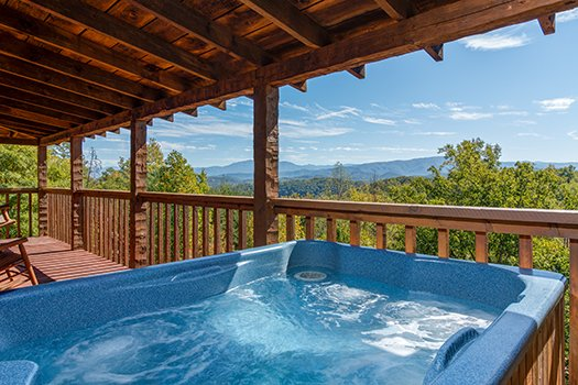 view from the hot tub on the covered deck at a postcard view a 1 bedroom cabin rental located in pigeon forge