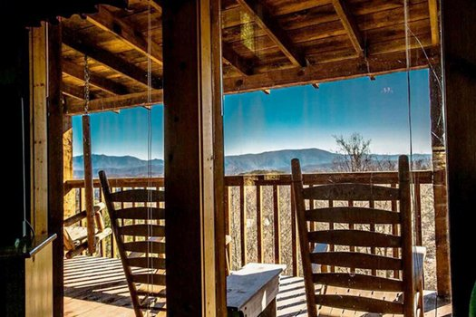 looking through the windows at the deck view at a postcard view a 1 bedroom cabin rental located in pigeon forge