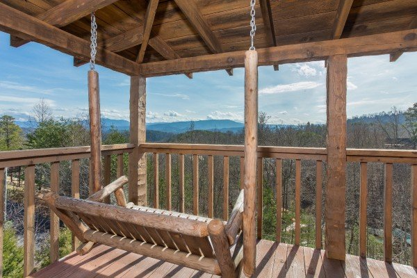 a mountain view from the porch swing at a postcard view a 1 bedroom cabin rental located in pigeon forge