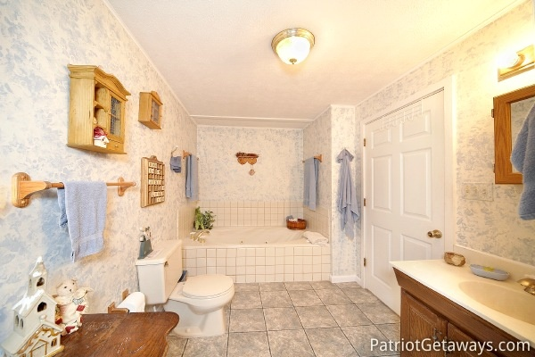 Bathroom at Dolly's Adorable River Cottage, a 3-bedroom cabin rental located in Pigeon Forge