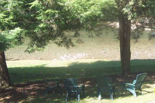 Seating by the river at Dolly's Adorable River Cottage, a 3-bedroom cabin rental located in Pigeon Forge