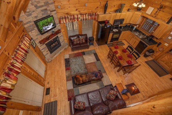 Looking down at the living room, dining room, and kitchen at Southern Comfort Memories, a 2 bedroom cabin rental located in Pigeon Forge