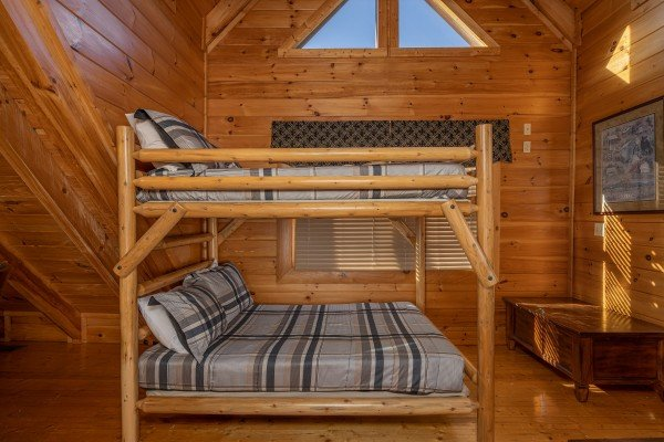Bunk beds in the loft at Southern Comfort Memories, a 2 bedroom cabin rental located in Pigeon Forge