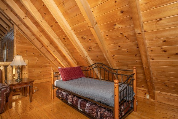 Daybed in the loft at Southern Comfort Memories, a 2 bedroom cabin rental located in Pigeon Forge