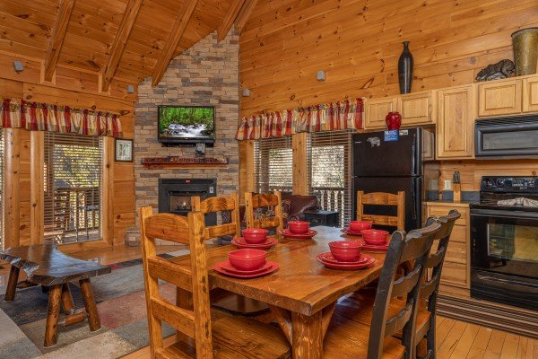 Dining table for six in the kitchen at Southern Comfort Memories, a 2 bedroom cabin rental located in Pigeon Forge