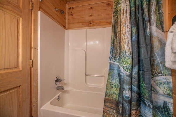 Bathroom with a tub and shower at Southern Comfort Memories, a 2 bedroom cabin rental located in Pigeon Forge
