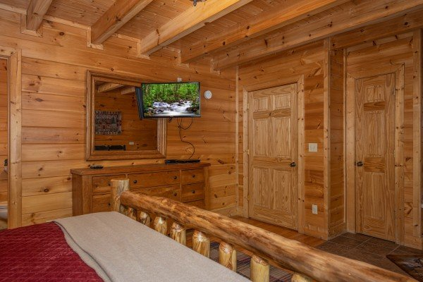 Dresser and TV in a bedroom at Southern Comfort Memories, a 2 bedroom cabin rental located in Pigeon Forge