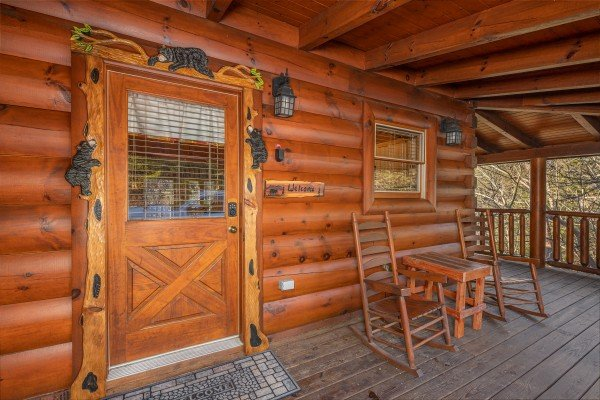 Custom bear woodwork front door at Southern Comfort Memories, a 2 bedroom cabin rental located in Pigeon Forge