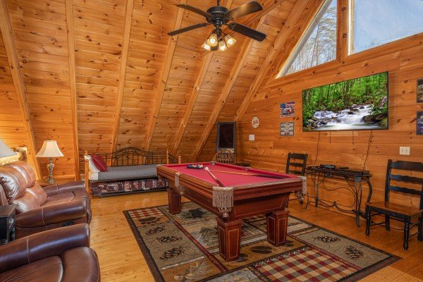 Loft with pool table, TV, day bed, and seating at Southern Comfort Memories, a 2 bedroom cabin rental located in Pigeon Forge