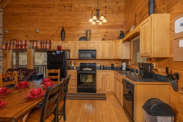 Kitchen with black appliances at Southern Comfort Memories, a 2 bedroom cabin rental located in Pigeon Forge