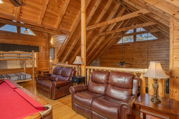 Leather seating in the loft at Southern Comfort Memories, a 2 bedroom cabin rental located in Pigeon Forge