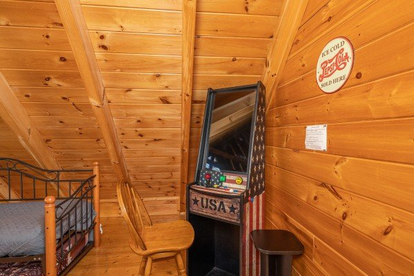 Video game in the loft at Southern Comfort Memories, a 2 bedroom cabin rental located in Pigeon Forge