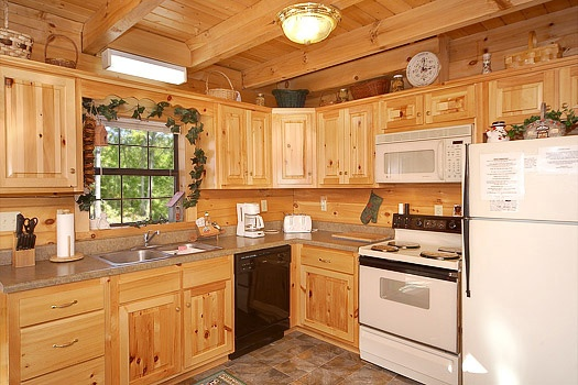 Kitchen with white appliances at Shy Bear, a 2 bedroom cabin rental located in Pigeon Forge