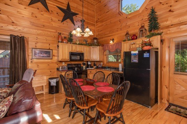 Dining room with seating for six at Bears Eye View, a 2-bedroom cabin rental located in Pigeon Forge