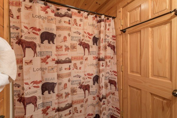 Bathroom with cabin decor at Bears Eye View, a 2-bedroom cabin rental located in Pigeon Forge